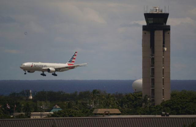 American Airlines lands at Daniel Inouye Airport.