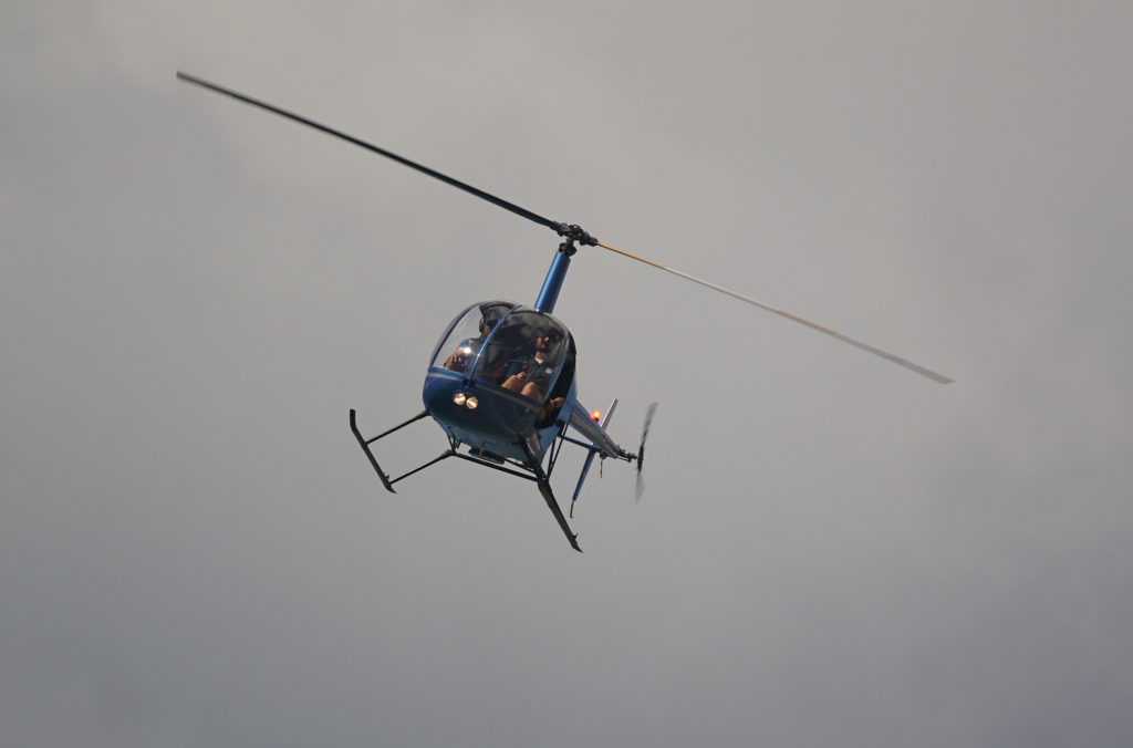 Robinson Helicopter leaves HNL airport. Daniel Inouye International Airport.