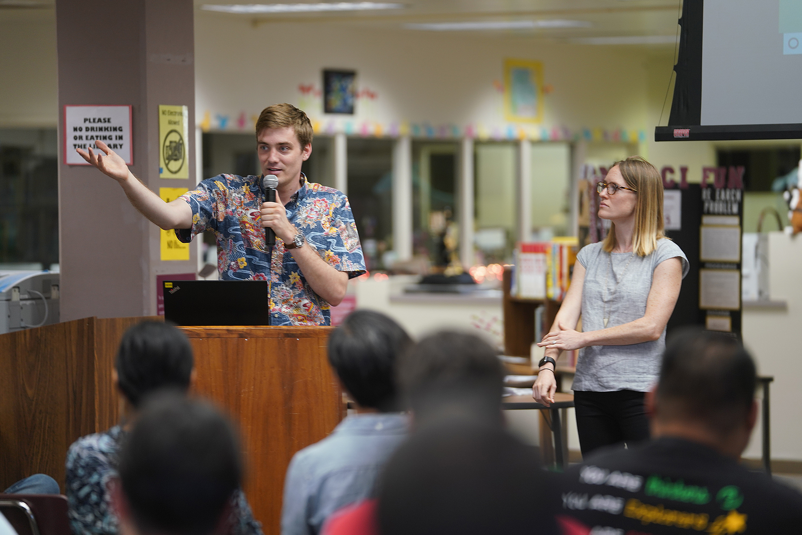 Ian Magruder from Landed shares how it works to Hawaii teachers gathered at Farrington High School library.