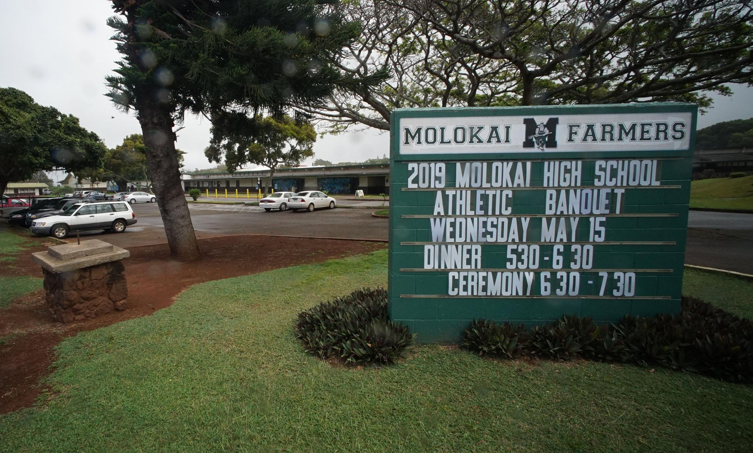 Molokai High School sign.