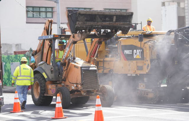 Machines work along McCully Street.