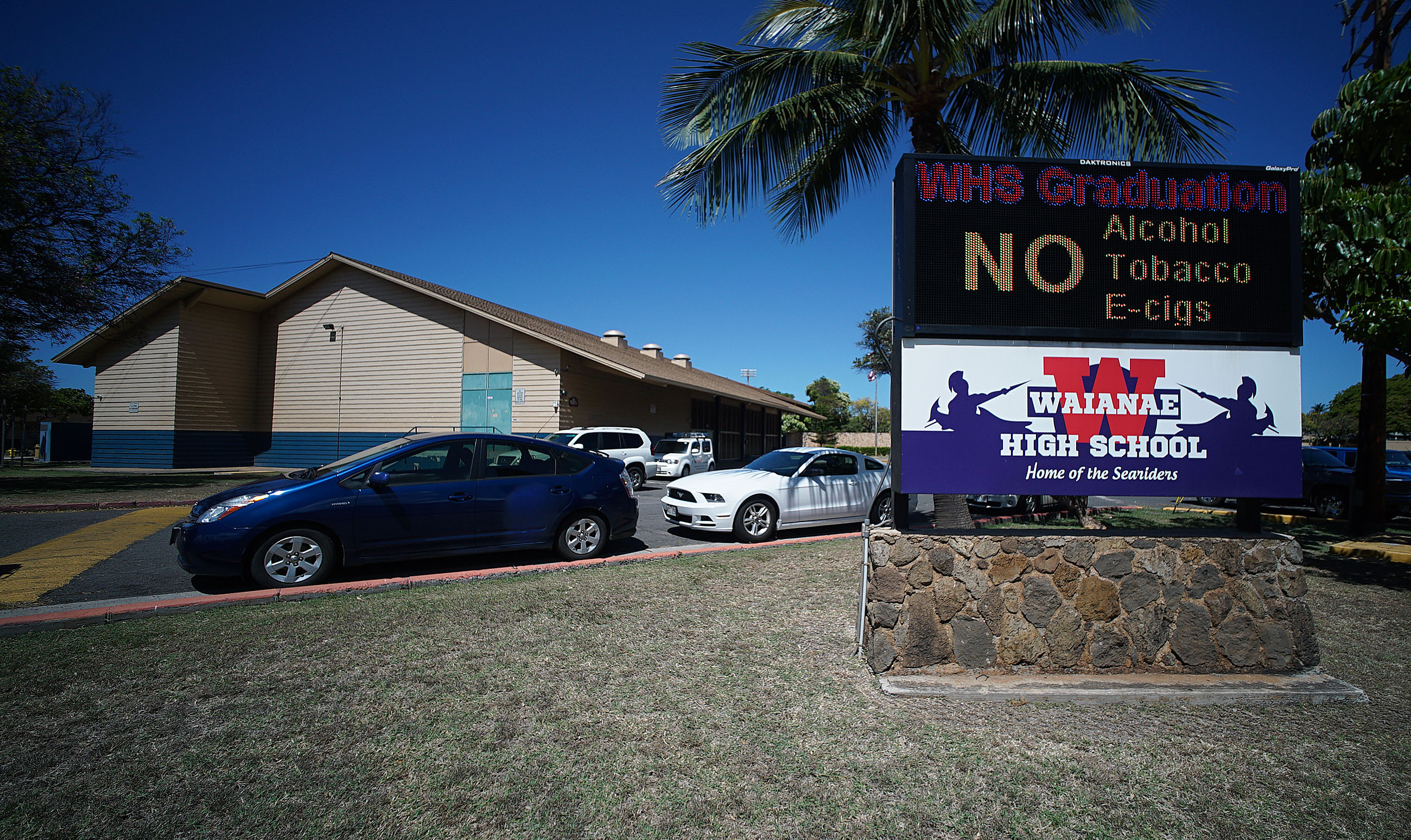 Waianae High School sign stating 'No Alcohol Tobacco E Cigs'.