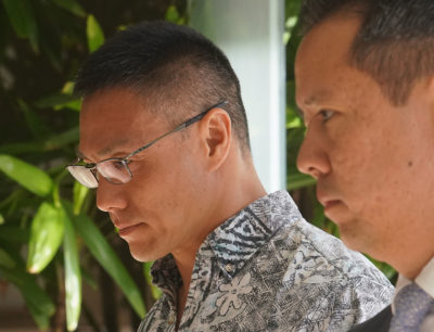 Left, Minh Hung 'Bobby' Nguyen arrives at District Court 1st day Kealoha Trial.