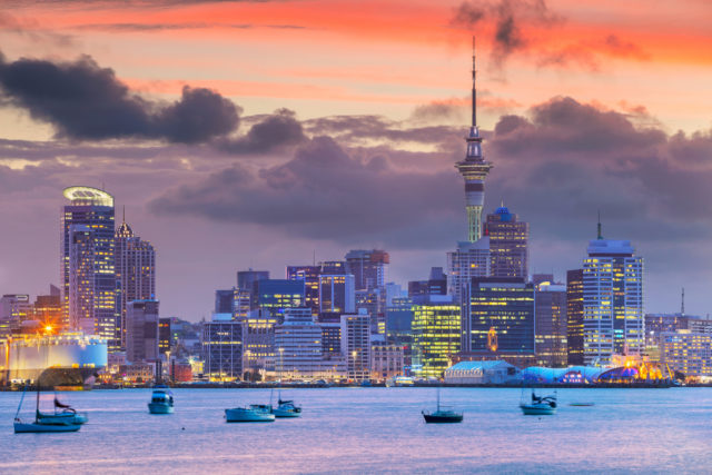 Cityscape image of Auckland skyline, New Zealand during sunset.
