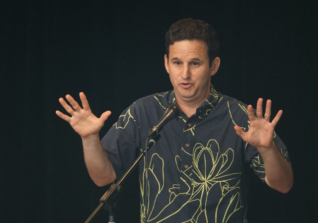 Senator Brian Schatz takes questions during his town hall meeting.