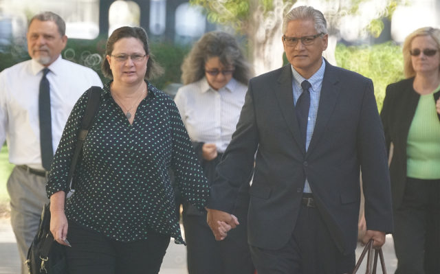 Former HPD Chief Louis Kealoha and Katherine Kealoha walk towards District Court.