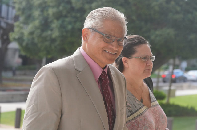 Former HPD Chief Louis Kealoha and Katherine Kealoha arrive at District Court.