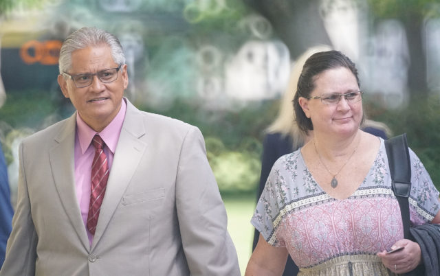 Former HPD Chief Louis Kealoha and Katherine Kealoha walk towards the District Court entrance.