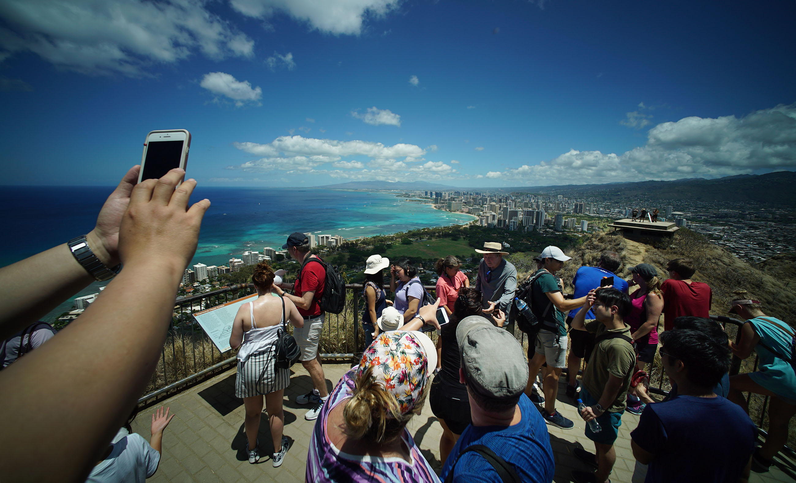 Hikers gather at the summit of Diamond Head lookout.