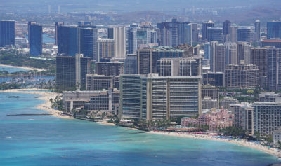 Royal Hawaiian Hotel sandwiched by larger Waikiki Hotels. Sheraton Hotel1