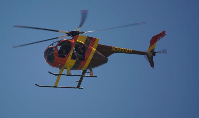 Magnum Helicopters aircraft flies above Magic Island/Ala Moana Beach Park