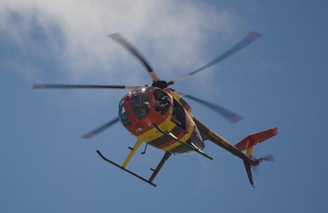 Magnum Helicopters open door tour flies over Ala Moana Beach.