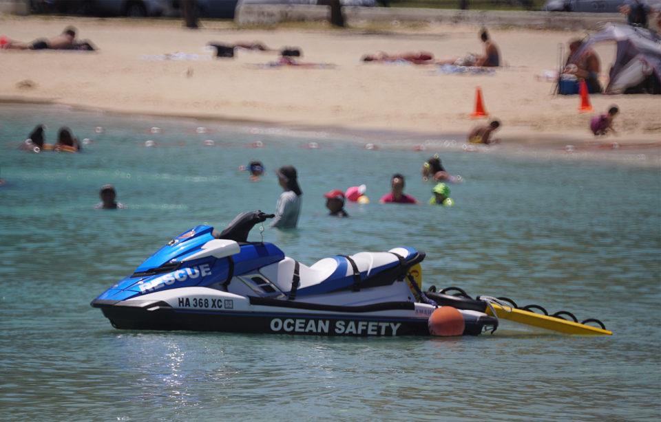 Ocean Safety Jet Ski sits near shore at Ala Moana Beach Park.