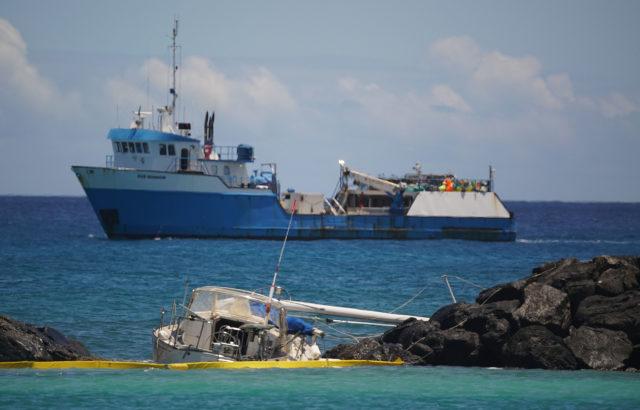 Stranded boat at the Magic Island break.