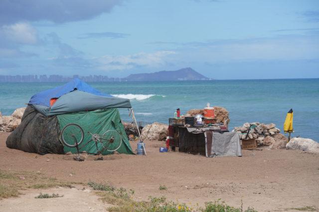 Tents on the west side of Hau Bush / Oneula Beach Park in Ewa.