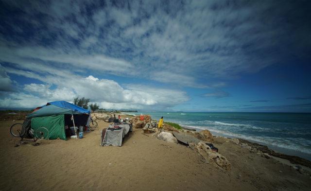 Tents along beach at Hau Bush / Oneula Beach Park.