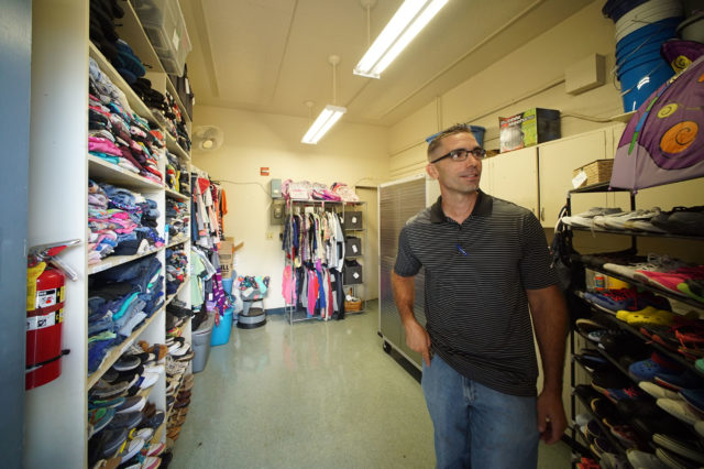 Waipahu Elementary School VP James Suster stands inside Auntie Carolyns closet, where students can get some donated clothes.