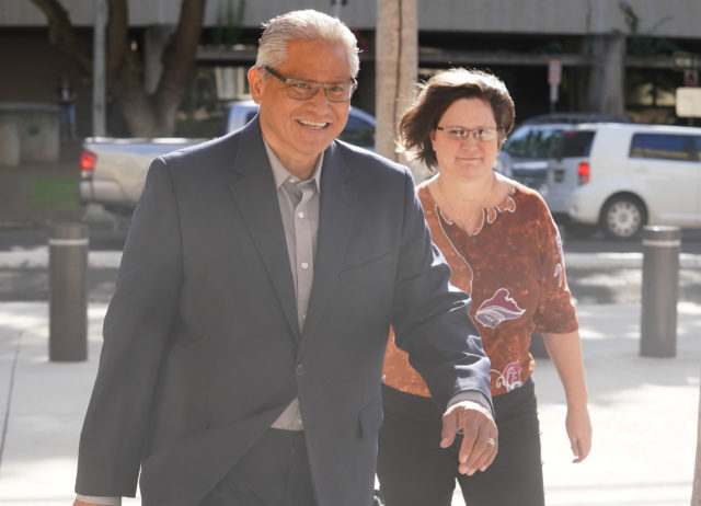 Former HPD Chief Louis Kealoha arrives with Katherine Kealoha to District Court.