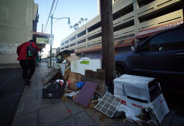 Trash along Maunakea Street on the Beretania end of Maunakea street.