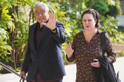 Katherine Kealoha and former HPD Chief Louis Kealoha arrive to District Court greeting media/tv camera guy with a friendly good morning.