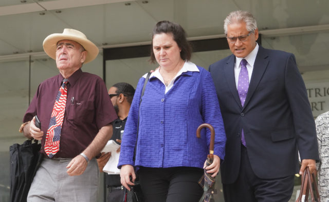 Left, Earle Partington, Katherine Kealoha and former HPD Chief Louis Kealoha leave District Court on lunch recess.