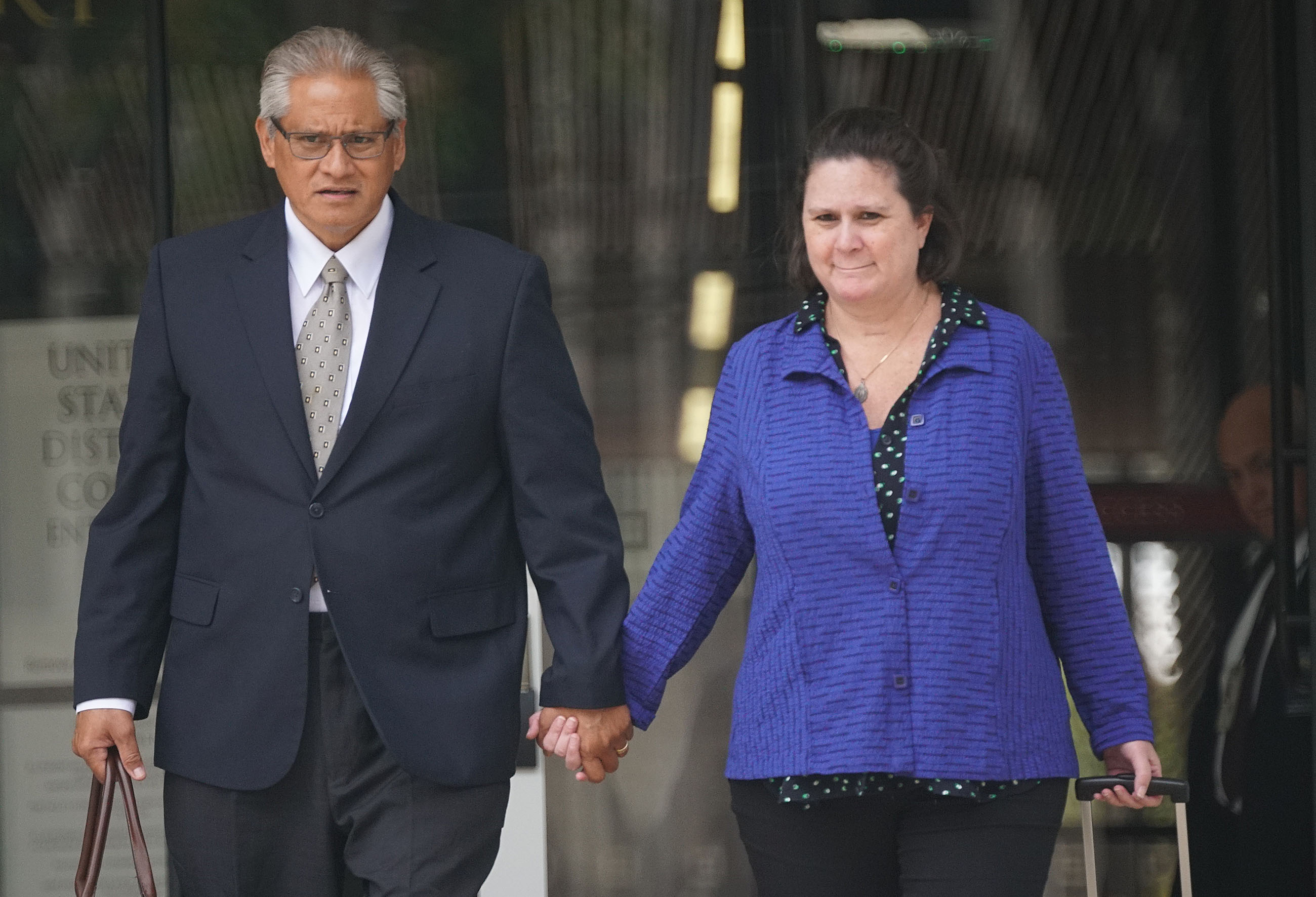 Former HPD Chief Louis Kealoha and Katherine Kealoha holding hands leaving District Court after jury deliberated.