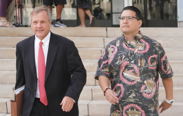 Derek Hahn leaves District Court with Attorney Birney Bervar after jury read verdict