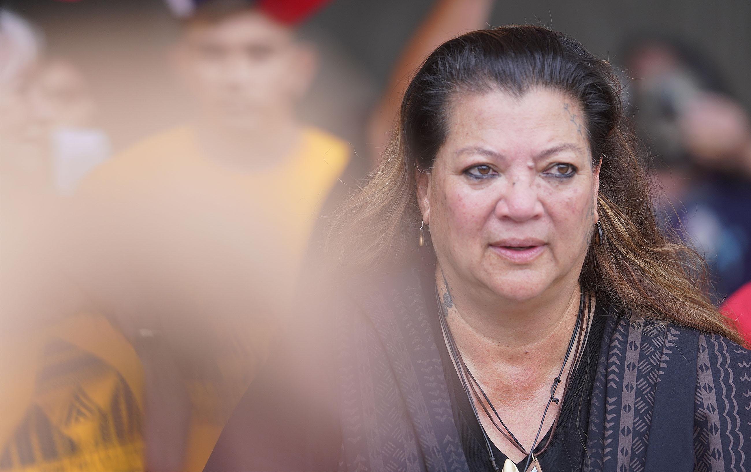 Kealoha Pisciotta speaks in opposition to TMT on Mauna Kea outside the Kalanimoku Building.