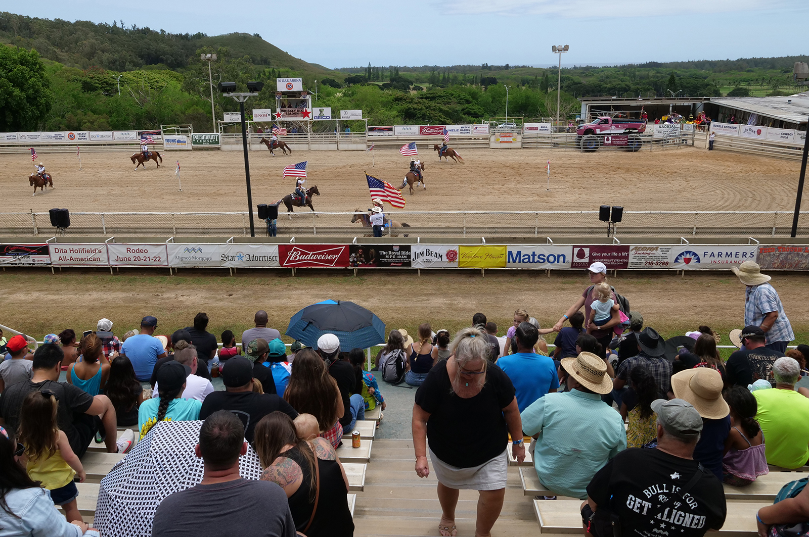 <p>Spectators watch the opening ceremony of the June 22 rodeo, which draws thousands of people each year.</p>