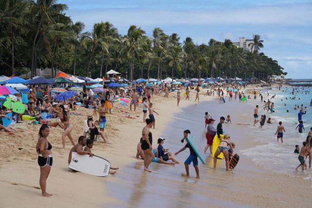 Crowds on 4th of July at Waikiki Beach near the Kapahulu groin .