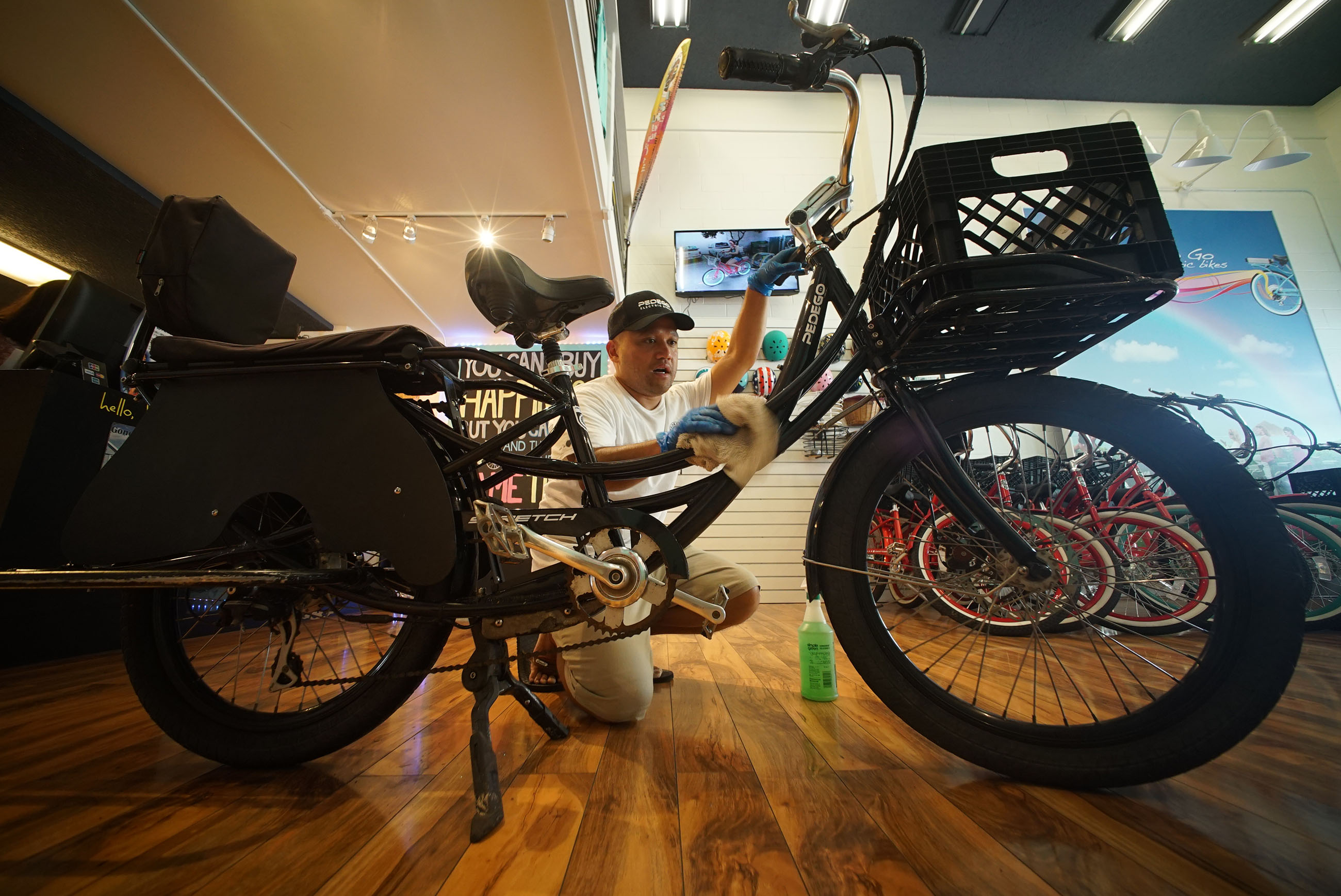 Kaipo Chung cleans up an electric bike ready for the next customer.