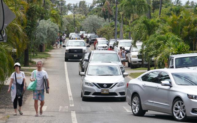 Lanikai Cyclists along Mokulua Drive with pedestrians.