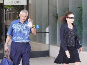 Louis Kealoha waves to media as he leaves hearing on July 11. 2019