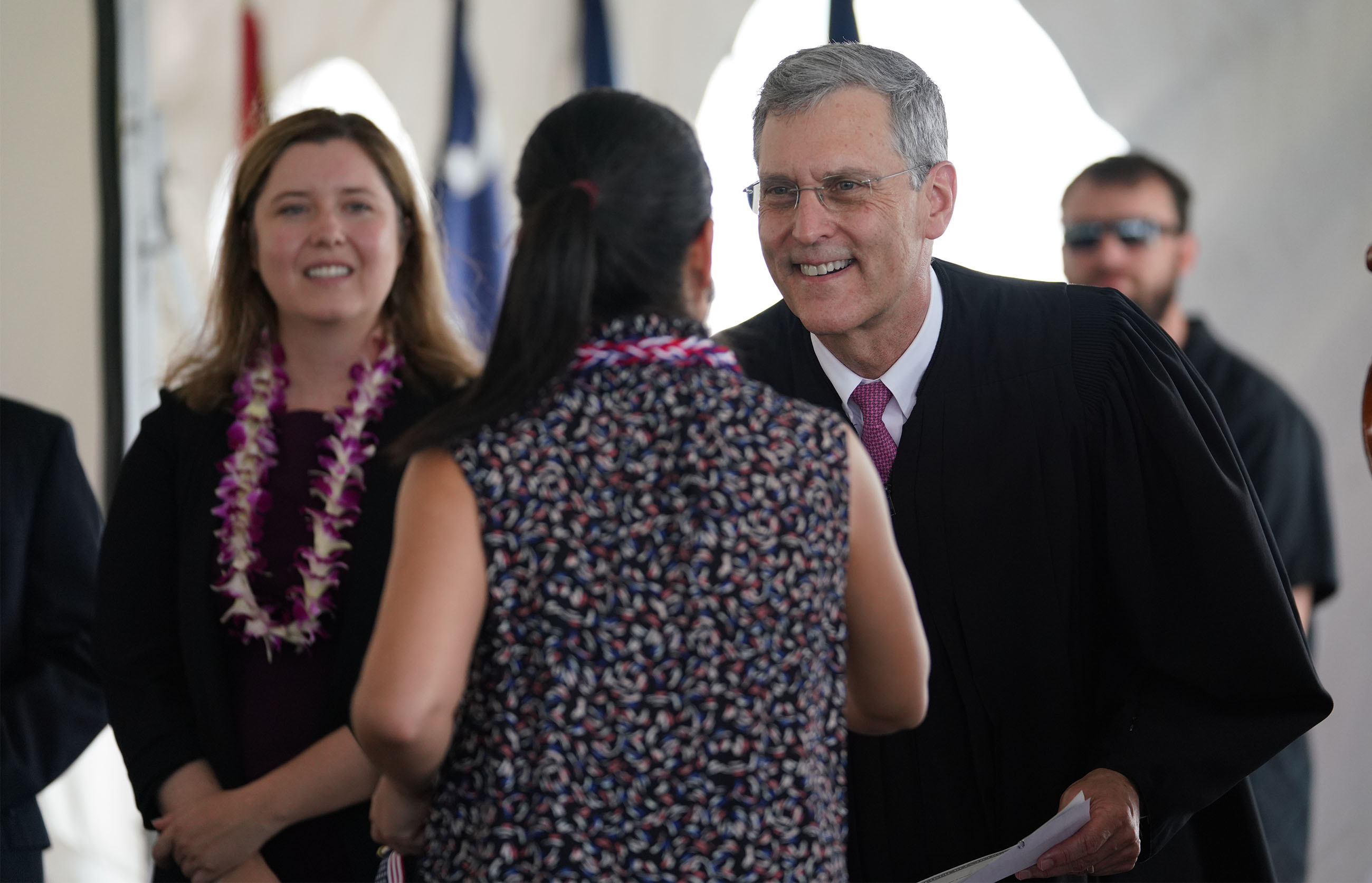 <p>U.S. District Court Judge J. Michael Seabright and Law Clerk Sara Haley greeted the participants. Seabright made welcoming remarks and administered the Oath of Allegiance.</p>