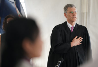 US District Court Chief Justice John Michael Seabright during Naturalization ceremonies held on the USS Missouri.