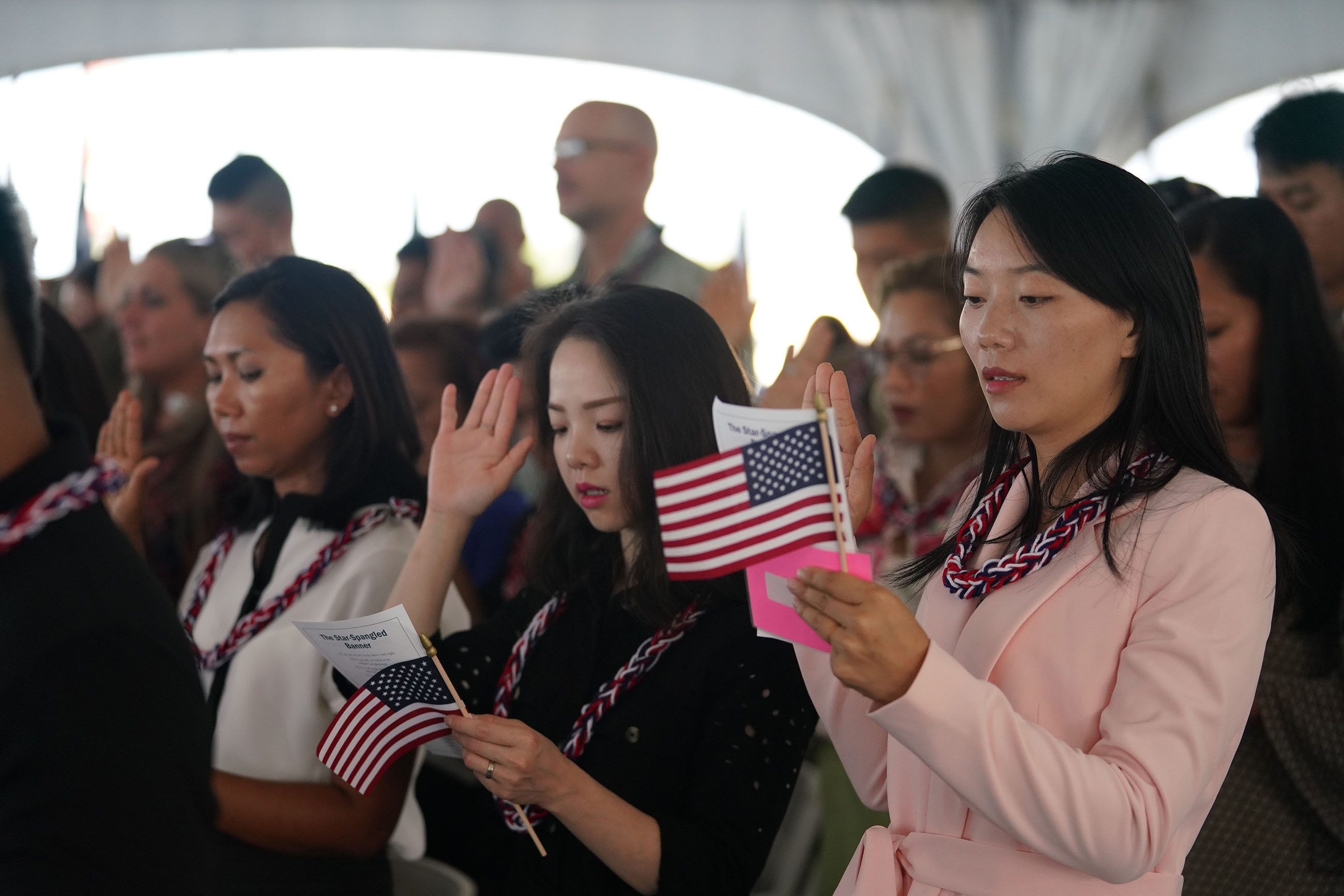 <p>Equipped with tiny American flags and the words to the Oath of Allegiance, participants cross the threshold.</p>