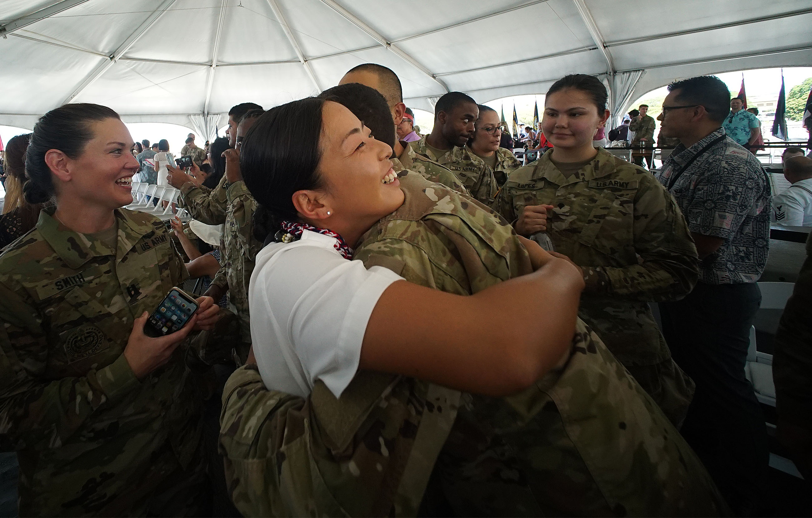 <p>After becoming an American citizen, Jiawen Liu hugs her U.S. Army supporters after the Thursday ceremony.</p>