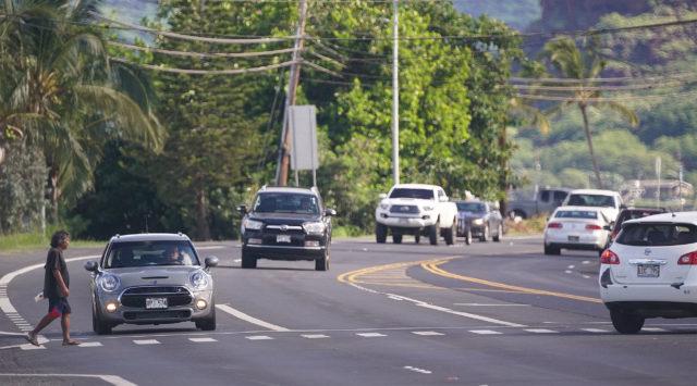 Pedestrian crosses near Farrington Highway near Leihoku Street in Waianae.
