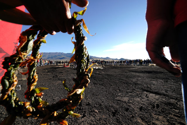 Maunakea Access road area, Circle of Supporters form a large circle.