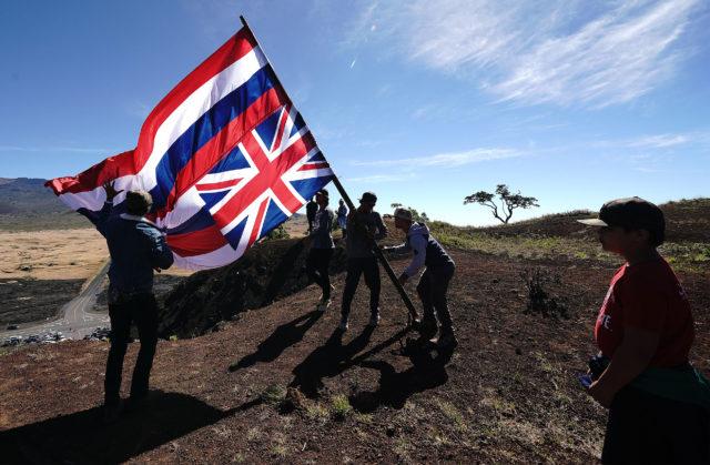 Moving Hawaiian Flag atop the Kipuka Pu'u Huluhulu, Native Tree Sanctuary and Trail above the Maunakea Access road.