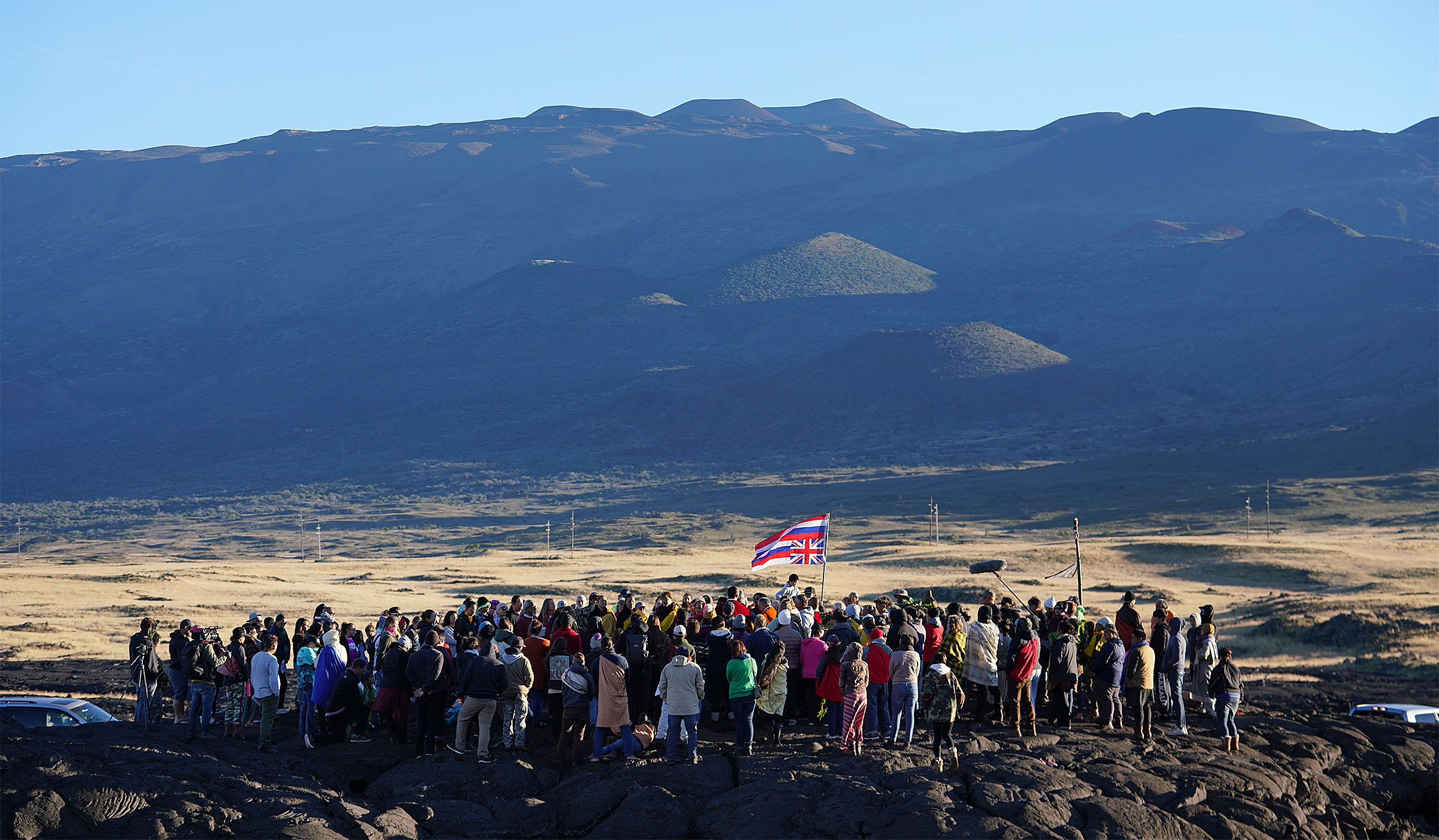 TMT Demonstrators gather at the ahu or altar near entrance of Maunakea Access Road.