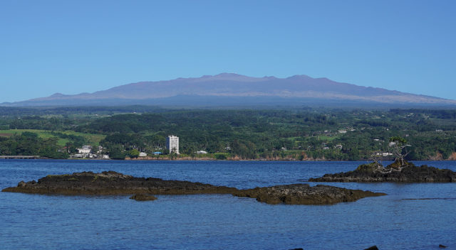 TMT Hilo waterfront with the TMT Mauna Kea Observatories. The tiny white dots on the top of Mauna Kea are the observatories.