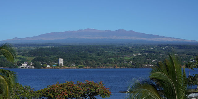 Hilo Bay with the majestic view of Mauna Kea with tiny dots on the summit, the observatories.