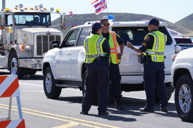 Hawaii Island Police officers with their subsidized vehicles along Saddle Road. July 15, 2019