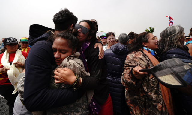 TMT Mauna Kea demonstrators hug. July 17, 2019