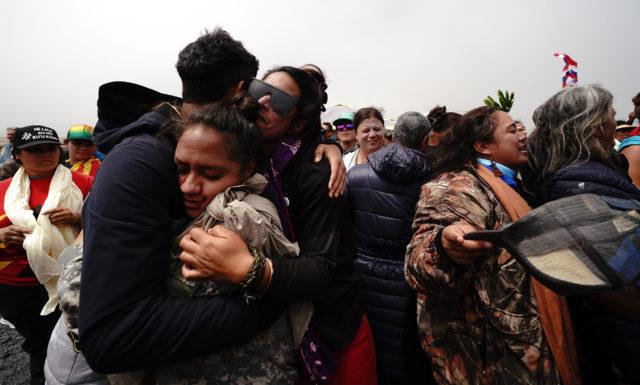TMT Mauna Kea demonstrators hug. July 17, 2019