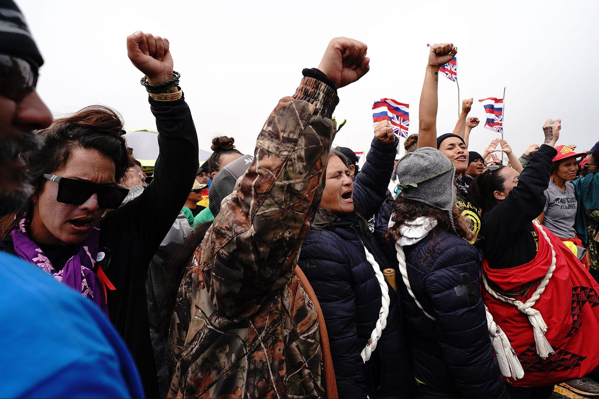 TMT Wahine Demonstrators cheer after law enforcement left, after negotiations over moving some unattended vehicles on the Saddle Road. July 17, 2019