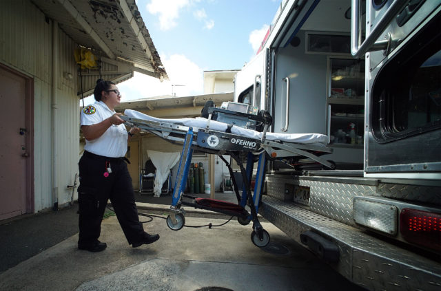 EMT Kiana Kaiwi loads the gurney into Wailupe City and County ambulance.