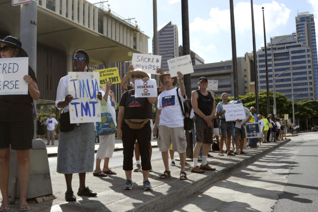 Supporters of the Thirty Meter Telescope gather for a rally outside the Hawaii State Capitol in Honolulu on Thursday, July 25, 2019. Supporters said the giant telescope planned for Hawaii's tallest mountain will enhance humanity's knowledge of the universe and bring quality, high-paying jobs, as protesters blocked construction for a second week. (AP Photo/Audrey McAvoy)