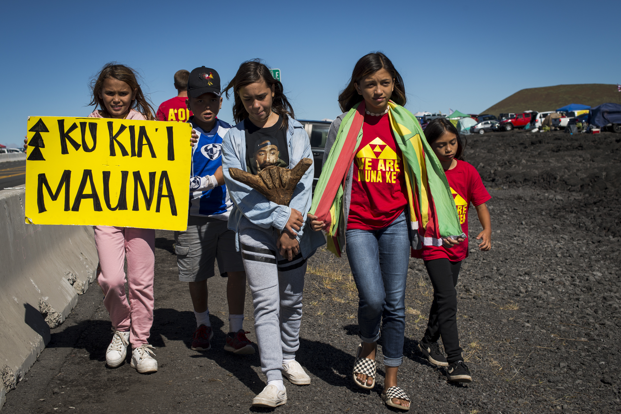 <p>Keiki head for breakfast and Friday morning classes after spending the night camping out. Multigenerational families are among the protesters who have so far blocked access up the mountain, preventing TMT construction vehicles from being brought in.</p>